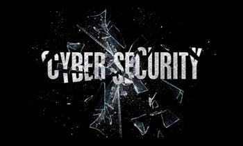 napis cybersecurity na tle potłuczonej szyby